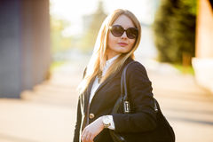 Portrait of young woman in sunglasses Stock Photos