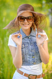 Portrait of young woman in sunglasses Stock Photo