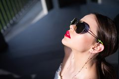 Portrait of a young woman in sunglasses. Close-up portrait of a beautiful charming young attractive lady. Young woman