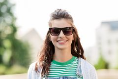 Portrait of young woman in sunglasses outdoors Royalty Free Stock Photos