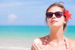 Portrait of Young woman in sunglasses putting sun Stock Photos