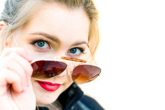 Portrait of a young woman in sunglasses, shallow depth of field Royalty Free Stock Photo