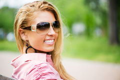 Portrait of Young Woman with Sunglasses Royalty Free Stock Photography