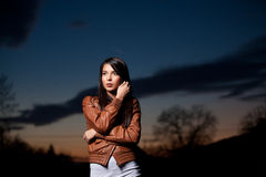A portrait of a young woman at sunset Royalty Free Stock Photography