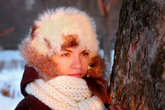 Portrait of young woman at sunset. Portrait of young woman in winter outwear Royalty Free Stock Photo