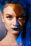 Portrait of young woman in superhero cosmetics Stock Photos