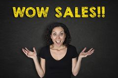 Portrait of young woman with a surprise expression and a `Wow Sales!!` text stock images