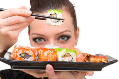 Portrait of young woman with sushi Stock Photography