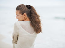 Portrait of young woman in sweater on lonely beach Stock Photo