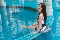 Portrait of young woman in swimming pool Stock Photos