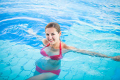 Portrait of a young woman  in a swimming pool Royalty Free Stock Images