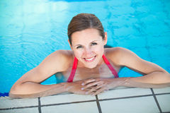 Portrait of a young woman  in a swimming pool Stock Image