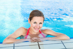 Portrait of a young woman  in a swimming pool Royalty Free Stock Image