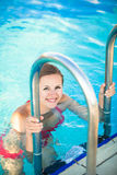 Portrait of a young woman  in a swimming pool Royalty Free Stock Photography