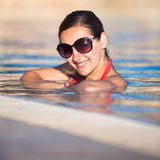 Portrait of a young woman  in a swimming pool Royalty Free Stock Photos