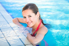 Portrait of a young woman  in a swimming pool Stock Photo