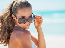 Portrait of young woman in swimsuit on beach making funny face Royalty Free Stock Photos