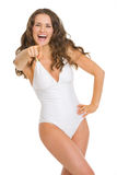 Portrait of woman in swimsuit pointing in camera Royalty Free Stock Images