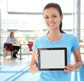Portrait of young woman with tablet stock images