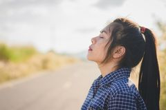 Portrait of young woman take a deep breath. At countryside stock images
