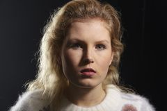 Portrait of a young woman taken with Rembrandt light Stock Images
