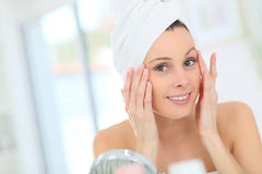 Portrait of a young woman taking care of her skin Royalty Free Stock Images
