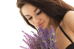 Portrait of young woman taking lavender Royalty Free Stock Images