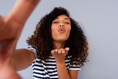 Young woman taking selfie and blowing a kiss Royalty Free Stock Image