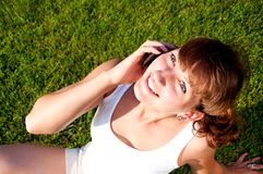Portrait of young woman talking on cell Stock Photos