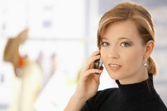 Portrait of young woman talking on mobile Stock Photography