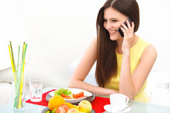 Portrait of a Young Woman Talking on Mobile Phone at Home Stock Photography