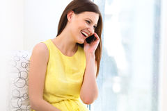 Portrait of a Young Woman Talking on Mobile Phone Stock Photos