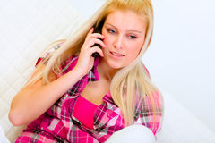 Portrait of young woman talking phone Stock Image