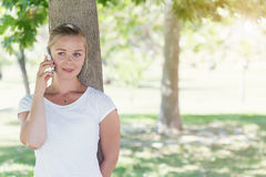 Portrait of young woman talking on a phone Royalty Free Stock Photo