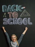 Portrait of a young woman, teacher in front of a blackboard Stock Photography