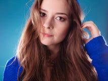 Portrait young woman teen girl long hair. Portrait of young woman teen girl long hair on blue Stock Image
