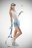 Portrait of young woman with tennis racket Stock Photo