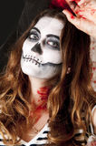 Portrait of young woman with terrifying makeup. Halloween holidays masquerade concept. Stock Images