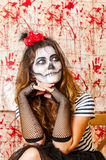 Portrait of young woman with terrifying makeup. Halloween holidays masquerade concept. Royalty Free Stock Photography