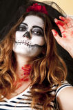 Portrait of young woman with terrifying makeup. Halloween holidays masquerade concept. Royalty Free Stock Photos