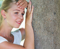 A portrait of a young woman thiking in sadness in Stock Photo