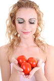 Portrait of young woman with tomatoes Royalty Free Stock Photo