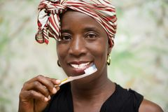 Portrait of young woman with a toothbrush stock photo
