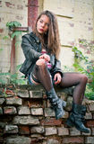 Portrait of a young woman in torn stockings Royalty Free Stock Photo