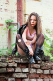 Portrait of a young woman in torn stockings Royalty Free Stock Photography