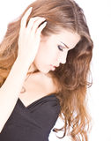 Portrait of young woman touching her long Royalty Free Stock Images