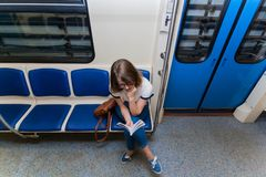 Portrait of young woman tourist in metro waggon royalty free stock photo