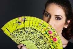 Portrait of woman with traditional fan Stock Photography