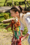 Portrait of a young woman and traditional puppet. Portrait of a young woman holding an traditional puppet made of wood  and pieces of cloth Royalty Free Stock Photos