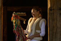 Portrait of a young woman and traditional puppet. Made of wood and pieces of cloth Stock Photography
